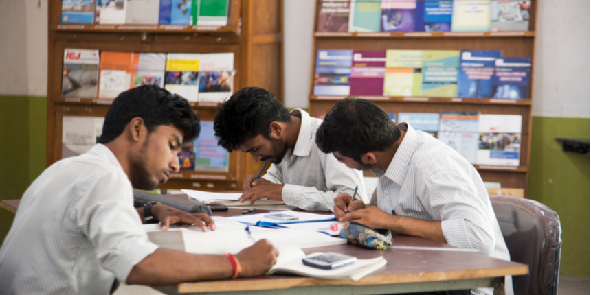 How do IITs set question papers for open-book exams?