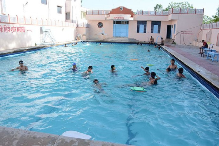 https://cache.careers360.mobi/media/colleges/social-media/media-gallery/15709/2019/1/6/Swimming pool of Agrawal PG College Jaipur_Others.JPG