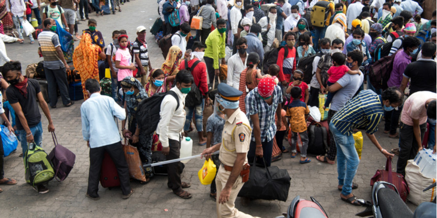 Migrant workers gather near IIMA gate demanding to be sent home