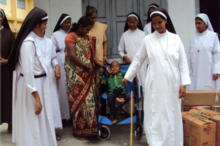 Carmel Convent School-Donating The Wheel Chair For The Disabled