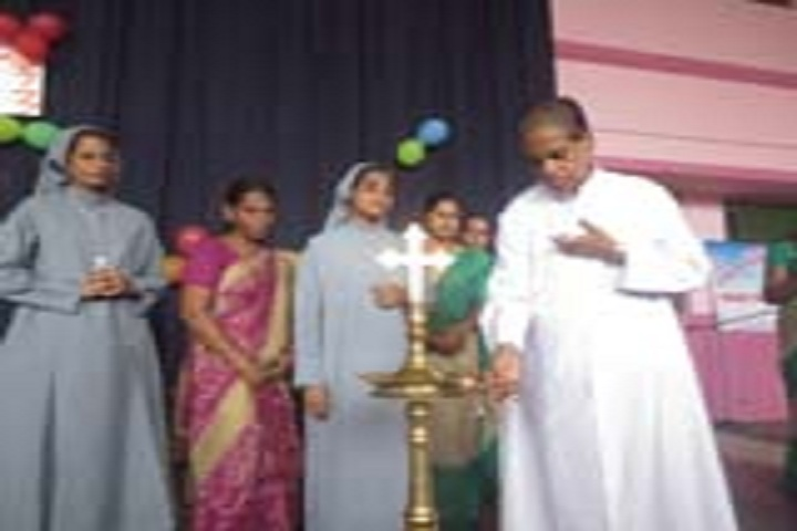 Mariam Thresia Public School-Lighting the lamp