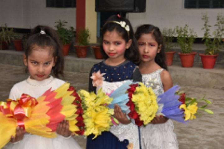 St Pushpa Senior Secondary School-Children with Flower Bokeh