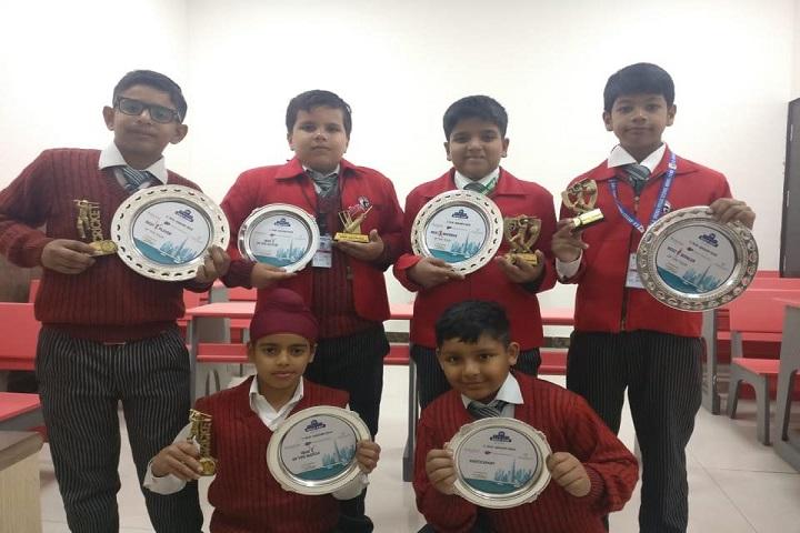 G D Goenka Public School-Students with trophies
