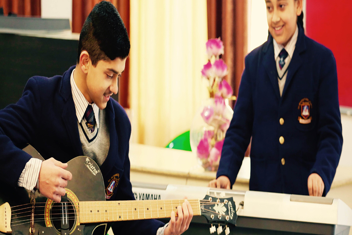 Sai International School-Guitar Player